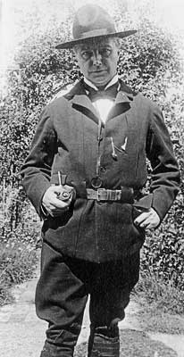 Edward Heron-Allen in his all-black scout uniform, c. 1915
